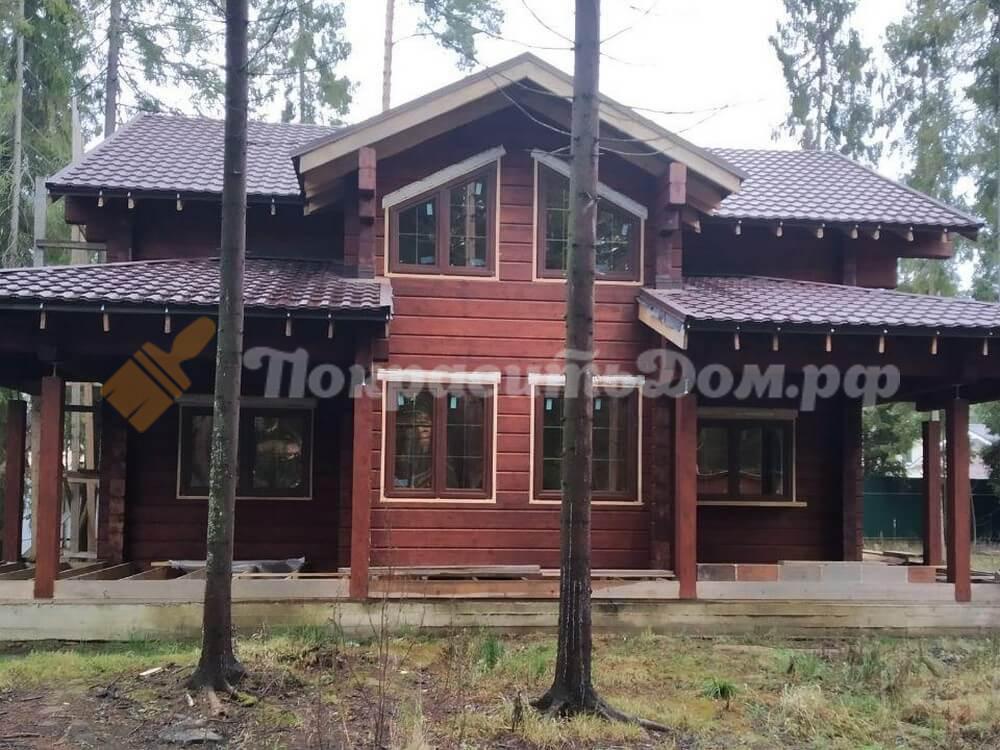 Шлифовка, очистка поверхности и покраска деревянного дома из клееного бруса